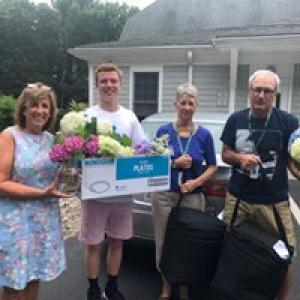 Home delivered meals staff and volunteers with meals and hydrangeas